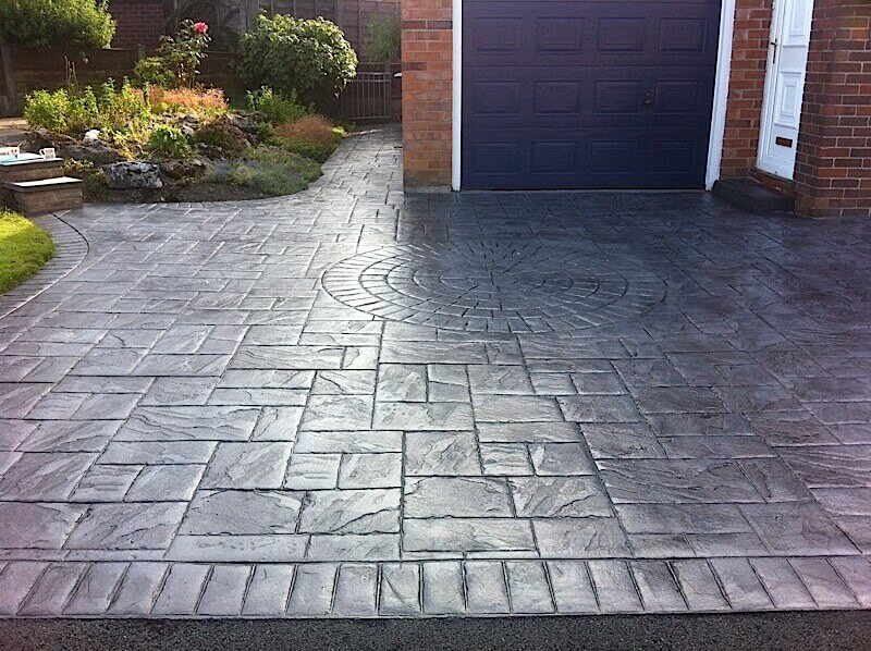 Grey slate printed patio in Glossop with geometric patterns