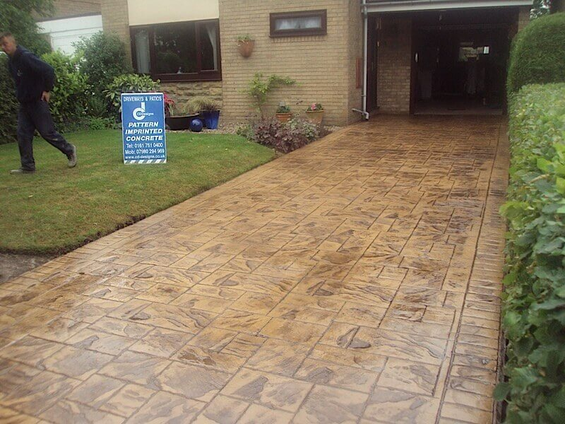 Long straight driveway in Stockport in sandstone slate