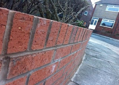 Bury brick wall