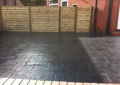 charcoal conrete surfacing with fencing