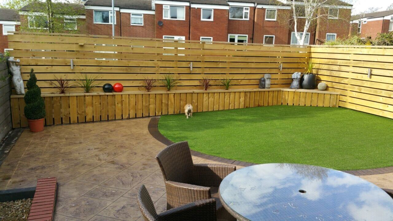 concrete patio and artificial grass design