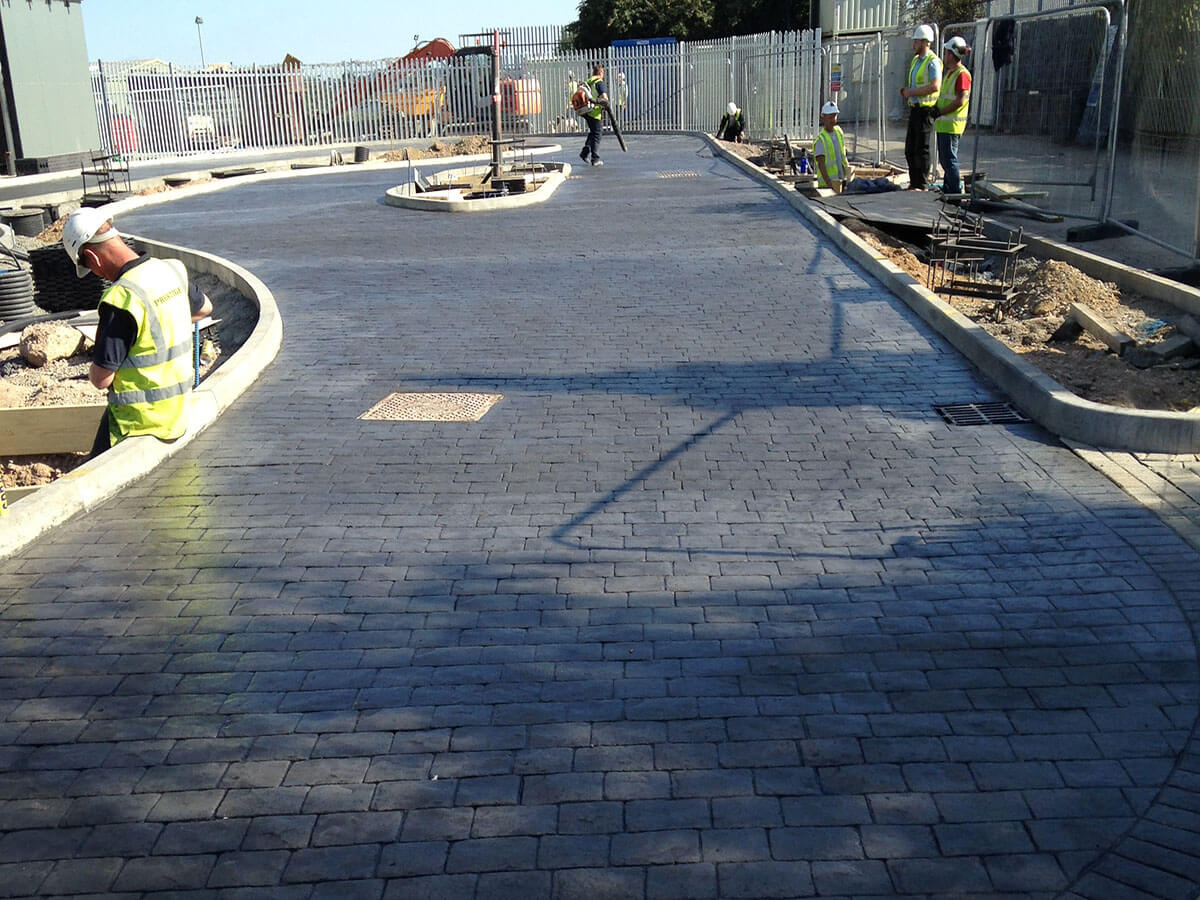 Charcoal imprinted concrete drive thru lane