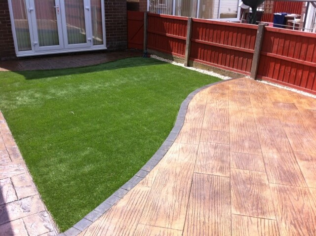 Light coloured concrete patio with wooden effect