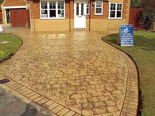 Tan Stone Imprinted Concrete Driveway