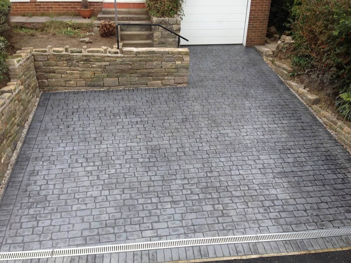 Grey sloping driveways in Darwen