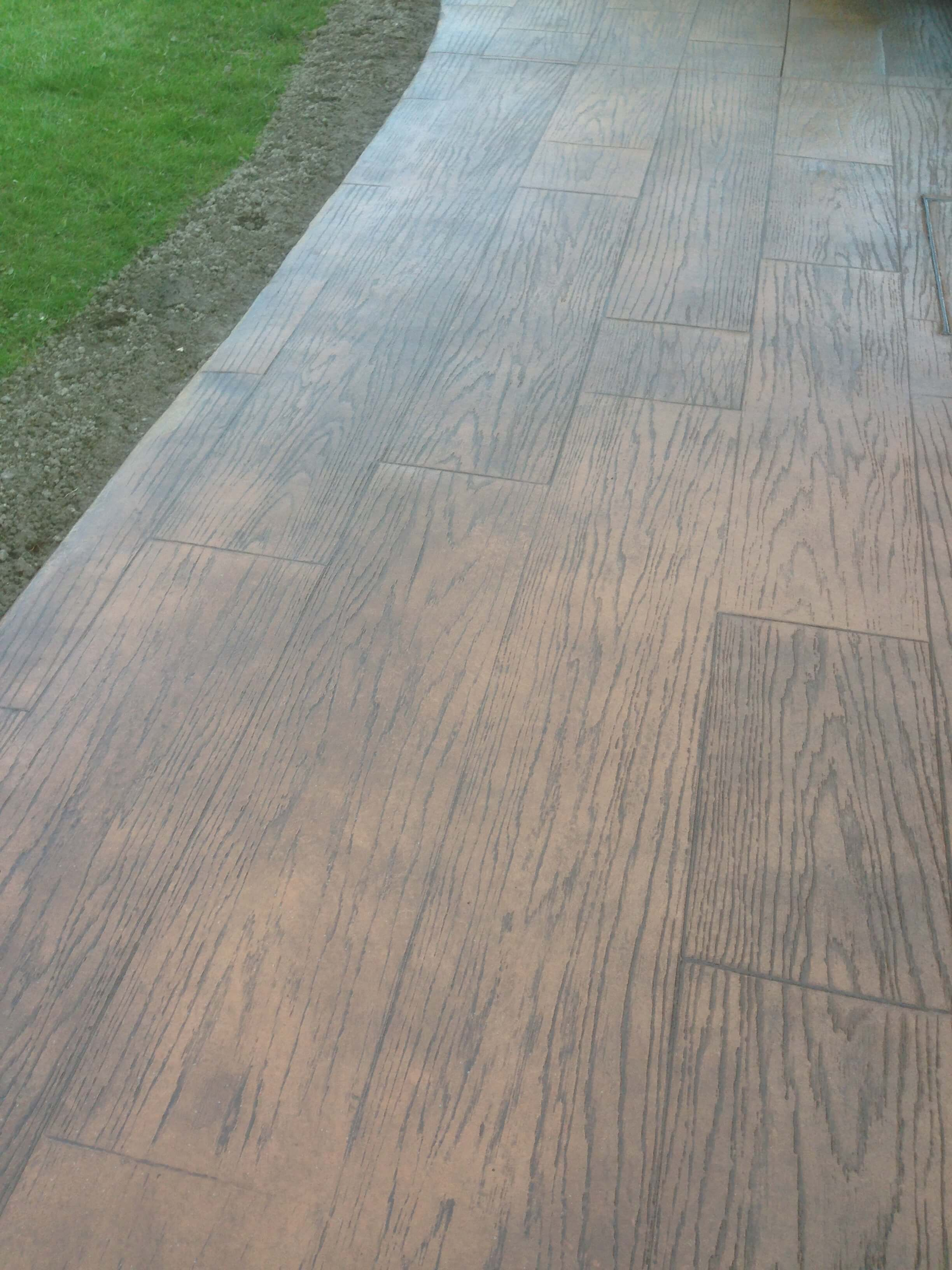Wooden decking print on concrete patio