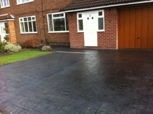 a finished driveway widened for 2 cars
