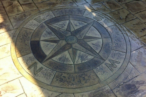 Pattern imprinted concrete compass design