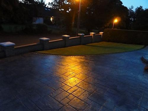 pattern-imprinted-concrete-by-night